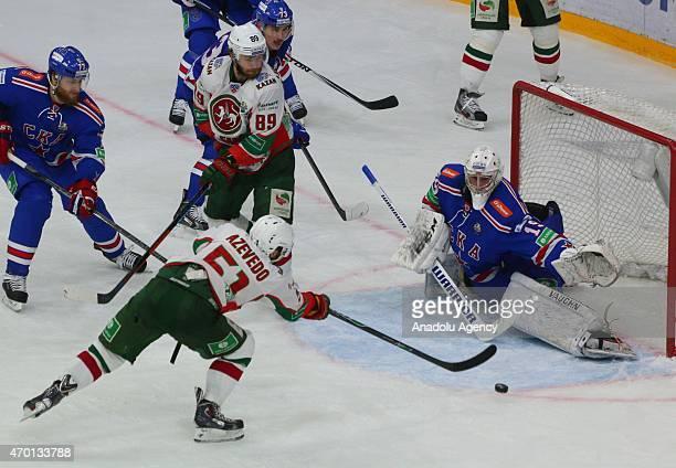 Goaltender Miko Koskinen and Anton Belov and Maxim Chudinov of SKA StPetersburg in action with Artem Lukianov and Justin Azevedo of AK Bars Kazan...