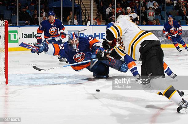 Goaltender Nathan Lawson of the New York Islanders dives unsuccessfully to stop a goal by Tyler Seguin of the Boston Bruins on February 17, 2011 at...