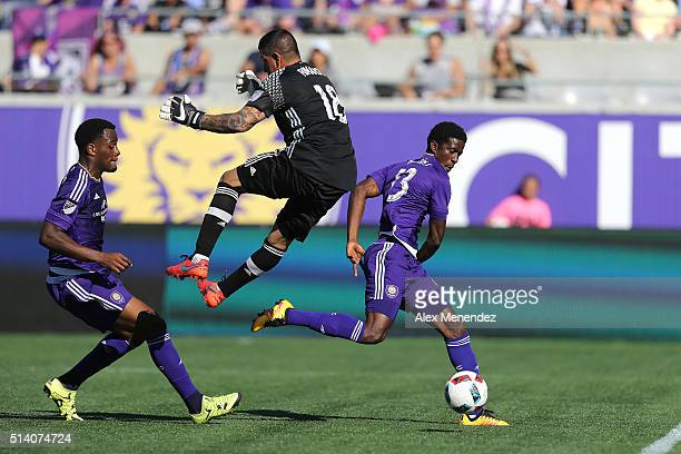 Goaltender Nick Rimando of Real Salt Lake leaps into Cyle Larin of Orlando City SC during a MLS soccer match between Real Salt Lake and the Orlando...