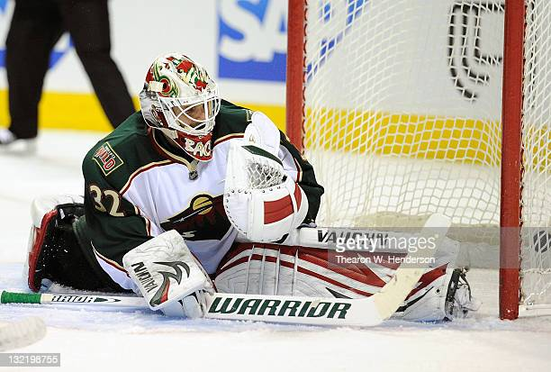 Goaltender Niklas Backstrom of the Minnesota Wild watches the puck go into the net off the stick of Patrick Marleau of the San Jose Sharks in the...