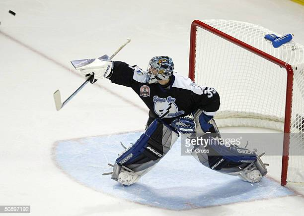 Goaltender Nikolai Khabibulin of the Tampa Bay Lightning deflects a shot against the Calgary Flames during the second period in game one of the NHL...