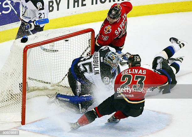 Goaltender Nikolai Khabibulin of the Tampa Bay Lightning stops a puck shot by Martin Gelinas of the Calgary Flames during the third period in game...
