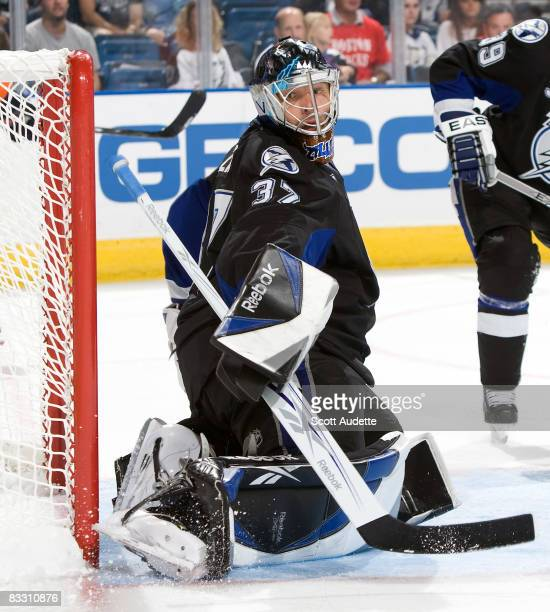 Goaltender Olaf Kolzig of the Tampa Bay Lightning looks back for the puck after making a save against the New York Islanders during the second period...
