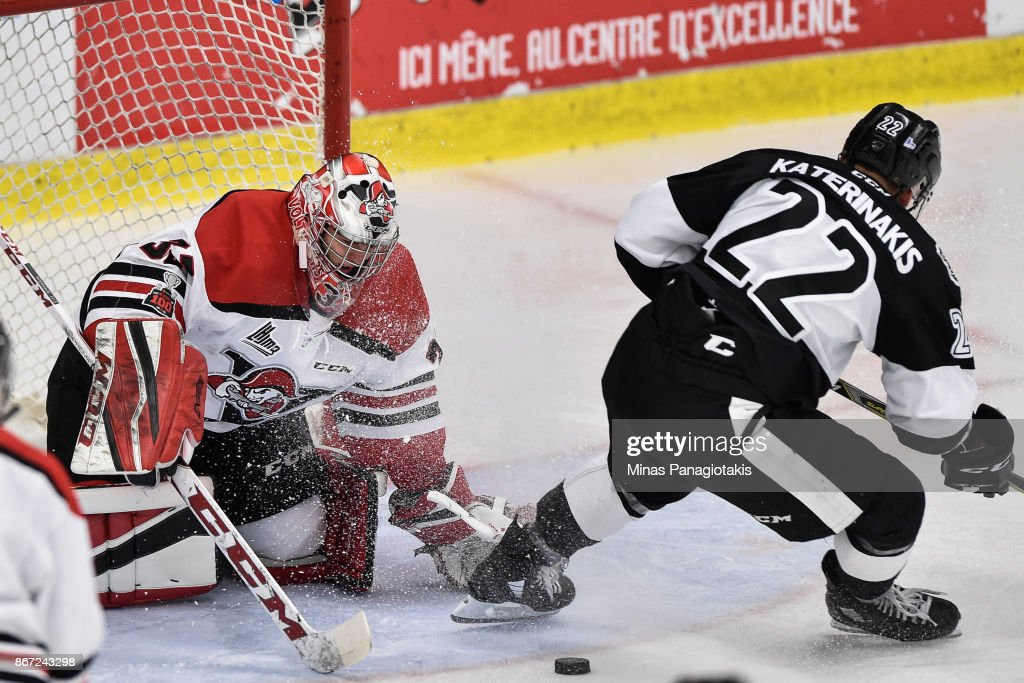 Goaltender Olivier Rodrigue #33 of the Drummondville Voltigeurs makes a save on Alexander Katerinakis #22 of the Blainville-Boisbriand Armada during the QMJHL game at Centre d'Excellence Sports Rousseau on October 27, 2017 in Boisbriand, Quebec, Canada.