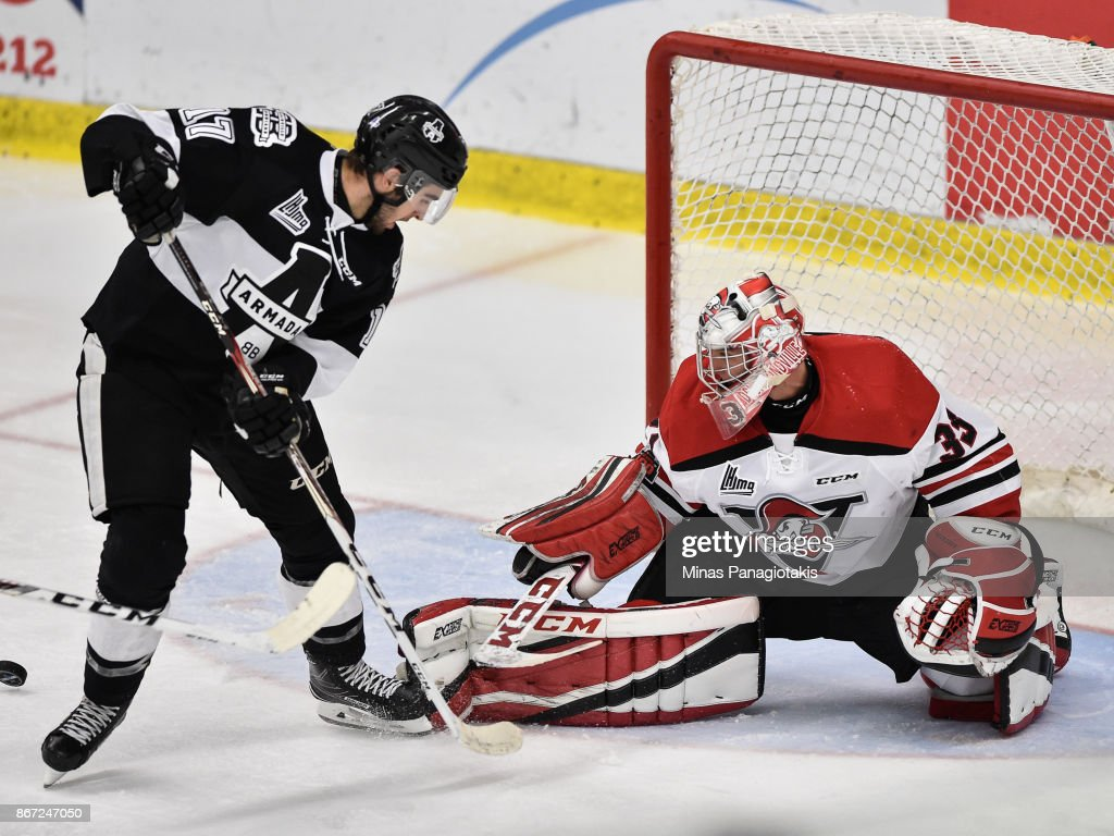 Goaltender Olivier Rodrigue #33 of the Drummondville Voltigeurs makes a save on Thomas Ethier #17 of the Blainville-Boisbriand Armada during the QMJHL game at Centre d'Excellence Sports Rousseau on October 27, 2017 in Boisbriand, Quebec, Canada. The Blainville-Boisbriand Armada defeated the Drummondville Voltigeurs 2-0.