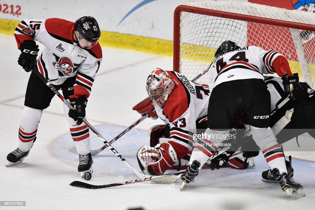 Goaltender Olivier Rodrigue #33 of the Drummondville Voltigeurs watches the puck near teammate Gregory Kreutzer #15 against the Blainville-Boisbriand Armada during the QMJHL game at Centre d'Excellence Sports Rousseau on October 27, 2017 in Boisbriand, Quebec, Canada. The Blainville-Boisbriand Armada defeated the Drummondville Voltigeurs 2-0.