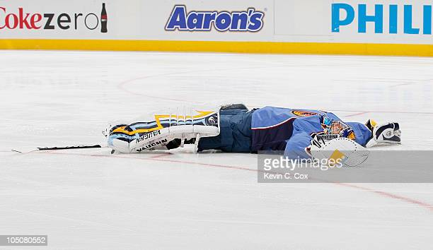 Goaltender Ondrej Pavelec of the Atlanta Thrashers lays on the ice after he fell backwards after losing consciousness in the first few minutes of the...