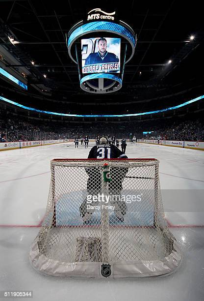 Goaltender Ondrej Pavelec of the Winnipeg Jets gets set in the crease prior to puck drop against the Dallas Stars at the MTS Centre on February 23...