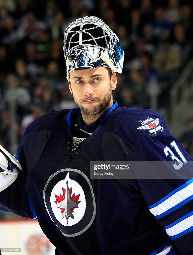 Goaltender Ondrej Pavelec #31 of the Winnipeg Jets looks on during a third period stoppage in play against the Vancouver Canucks at the MTS Centre on March 22, 2016 in Winnipeg, Manitoba, Canada.