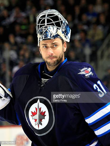 Goaltender Ondrej Pavelec of the Winnipeg Jets looks on during a third period stoppage in play against the Vancouver Canucks at the MTS Centre on...