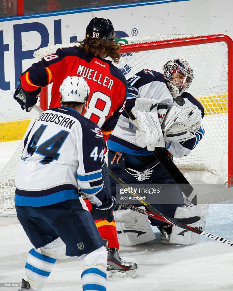 Goaltender Ondrej Pavelec #31 of the Winnipeg Jets stops a shot by Peter Mueller #88 of the Florida Panthers at the BB&T Center on March 5, 2013 in Sunrise, Florida. The Panthers defeated the Jets 4-1.