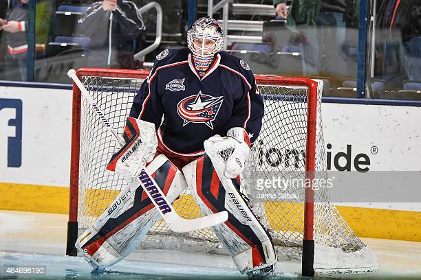 Goaltender Oscar Dansk of the Columbus Blue Jackets warms up before a game against the Montreal Canadiens on February 26 2015 at Nationwide Arena in...