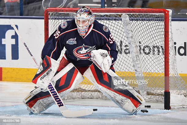 Goaltender Oscar Dansk of the Columbus Blue Jackets warms up prior to a game against the Montreal Canadiens on February 26 2015 at Nationwide Arena...