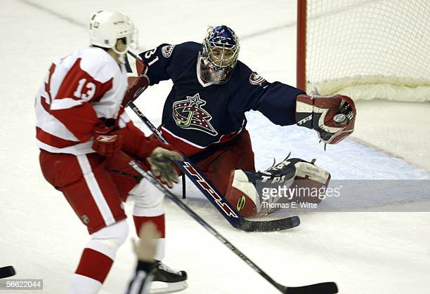Goaltender Pascal Leclaire of the Columbus Blue Jackets makes a save against Pavel Datsyuk of the Detroit Red Wings at Nationwide Arena January 18,...