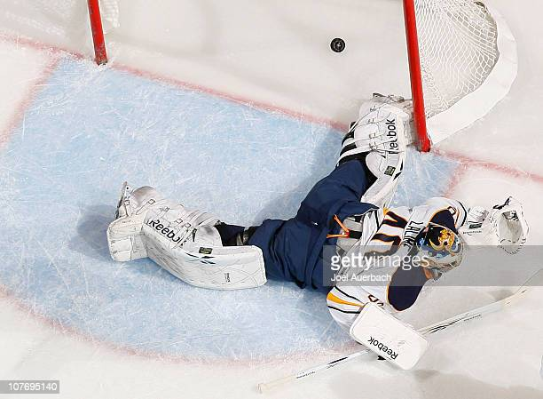 Goaltender Patrick Lalime of the Buffalo Sabres lies on the ice as the puck shot by Michael Frolik of the Florida Panthers scores on December 17,...