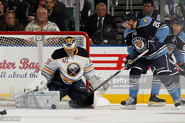 Goaltender Patrick Lalime of the Buffalo Sabres makes a save with Steve Bernier of the Florida Panthers waiting for a rebound in the second period on...