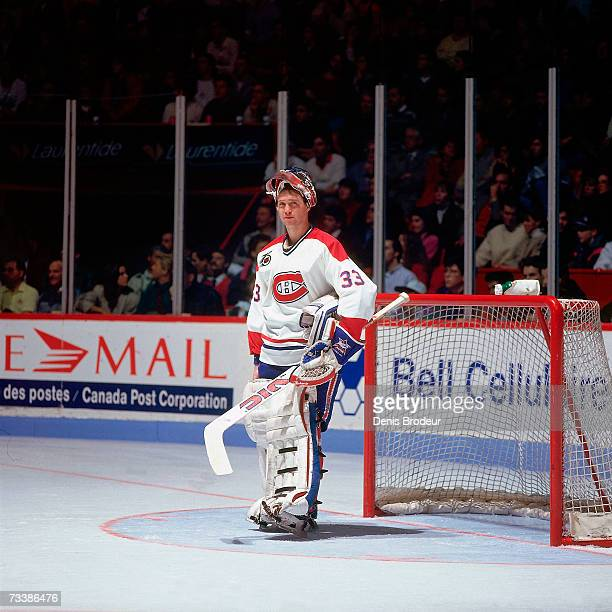 Goaltender Patrick Roy of the Montreal Canadiens looks on with his mask up during the game