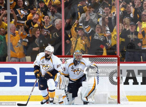 Goaltender Pekka Rinne and Vernon Fiddler react after the puck goes in the net off Fiddler on a goal by Scott Wilson of the Pittsburgh Penguins...
