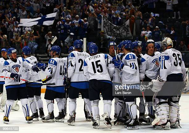 Goaltender Pekka Rinne of Finland celebrates with his team mates after winning the IIHF World Championship qualification round match between Finland...
