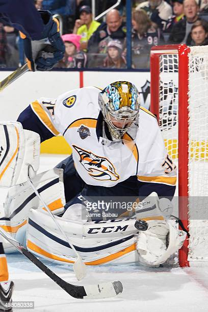 Goaltender Pekka Rinne of the Nashville Predators makes a glove save during the first period of a game against the Columbus Blue Jackets on November...