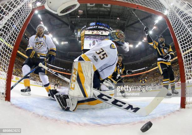 Goaltender Pekka Rinne of the Nashville Predators reacts as Bryan Rust of the Pittsburgh Penguins celebrates a goal by teammate Nick Bonino during...