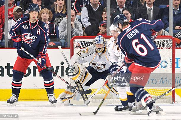 Goaltender Pekka Rinne of the Nashville Predators stops a shot from Rick Nash of the Columbus Blue Jackets during the second period on March 31, 2009...