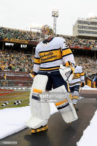Goaltender Pekka Rinne of the Nashville Predators walks back to the locker room after warmup prior to the 2020 NHL Winter Classic between the...