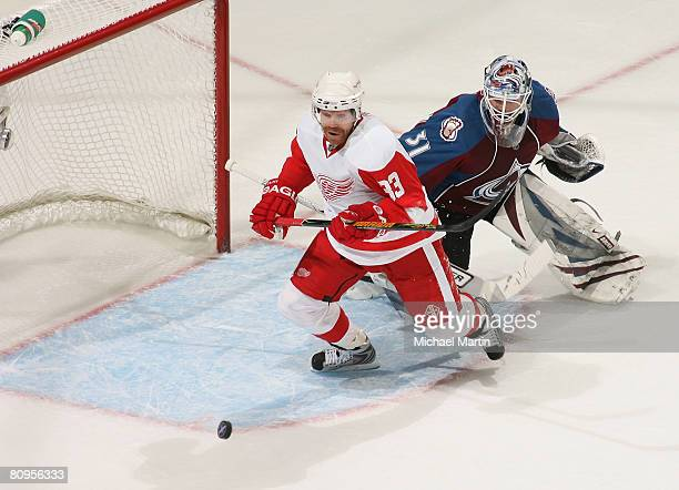 Goaltender Peter Budaj of the Colorado Avalanche defends the net against Kris Draper of the Detroit Red Wings during game four of the Western...