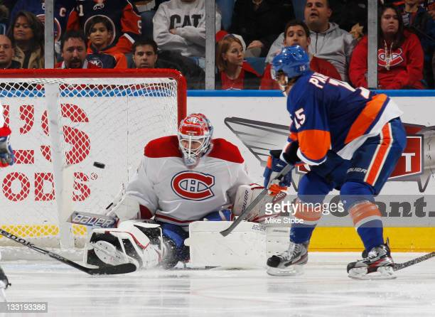 Goaltender Peter Budaj of the Montreal Canadiens watches the puck shoot past him into the net for a secondperiod goal by PA Parenteau of the New York...
