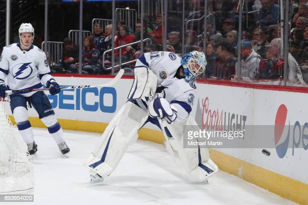 Goaltender Peter Budaj of the Tampa Bay Lightning clears the puck against the Colorado Avalanche at the Pepsi Center on December 16 2017 in Denver...