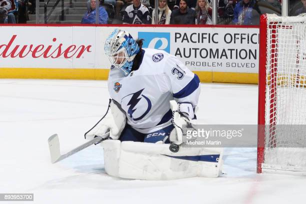 Goaltender Peter Budaj of the Tampa Bay Lightning makes a pad save against the Colorado Avalanche at the Pepsi Center on December 16 2017 in Denver...