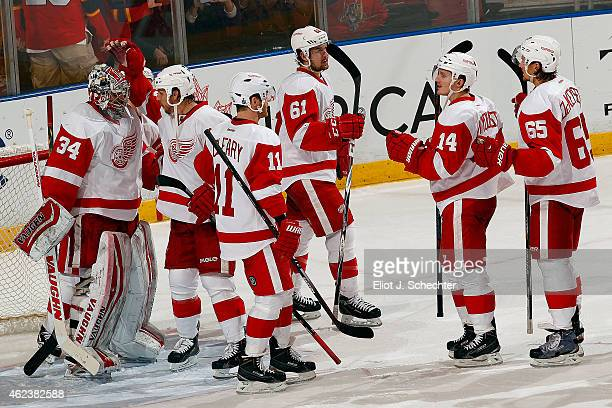 Goaltender Petr Mrazek of the Detroit Red Wings celebrates their win with teammate Stephen Weiss against the Florida Panthers at the BBT Center on...