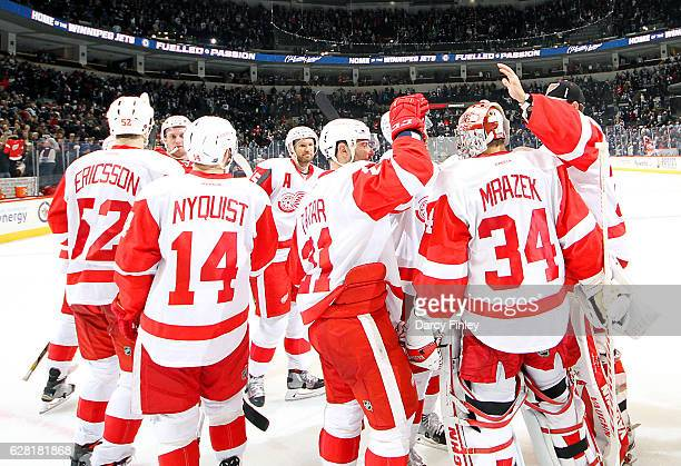 Goaltender Petr Mrazek of the Detroit Red Wings gets congratulated by teammates after backstopping the team to a 43 shootout victory over the...