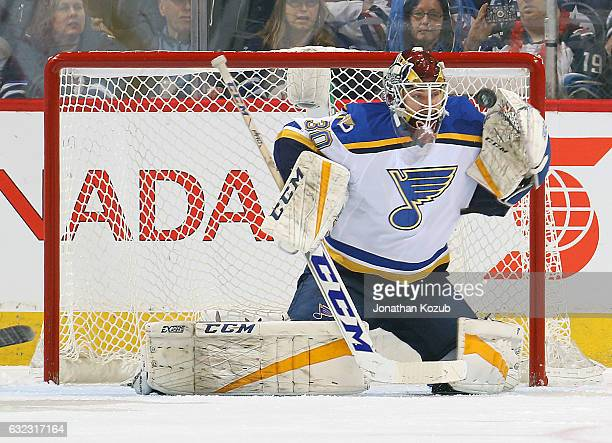 Goaltender Pheonix Copley of the St Louis Blues makes a glove save during first period action against the Winnipeg Jets at the MTS Centre on January...
