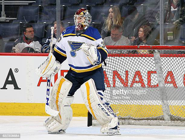 Goaltender Pheonix Copley of the St Louis Blues takes part in the pregame warm up prior to NHL action against the Winnipeg Jets at the MTS Centre on...