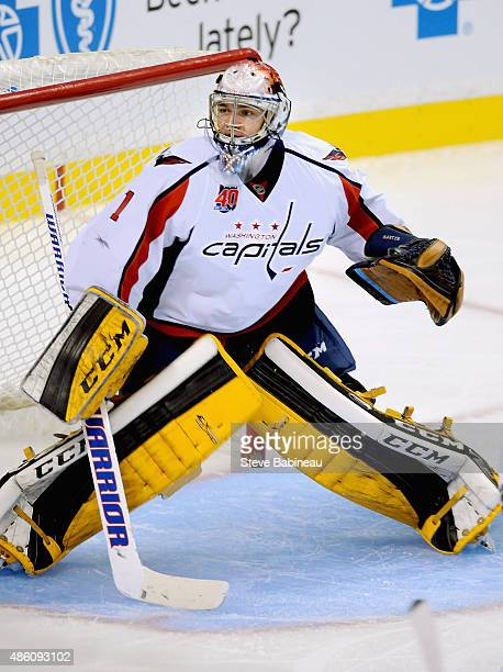 Goaltender Pheonix Copley of the Washington Capitals plays against the Boston Bruins during the game at TD Garden on September 24 2014 in Boston...