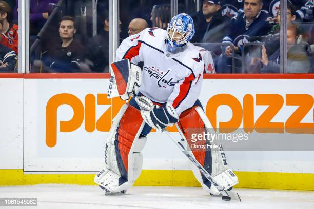 Goaltender Pheonix Copley of the Washington Capitals plays the puck along the boards during first period action against the Winnipeg Jets at the Bell...