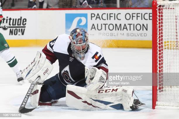 Goaltender Philipp Grubauer of the Colorado Avalanche makes a glove save against the Minnesota Wild at the Pepsi Center on January 23 2019 in Denver...