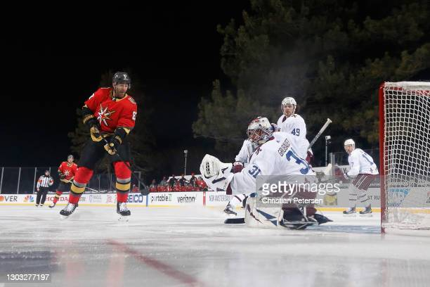 Goaltender Philipp Grubauer of the Colorado Avalanche makes a glove save on a shot from Max Pacioretty of the Vegas Golden Knights during the 'NHL...