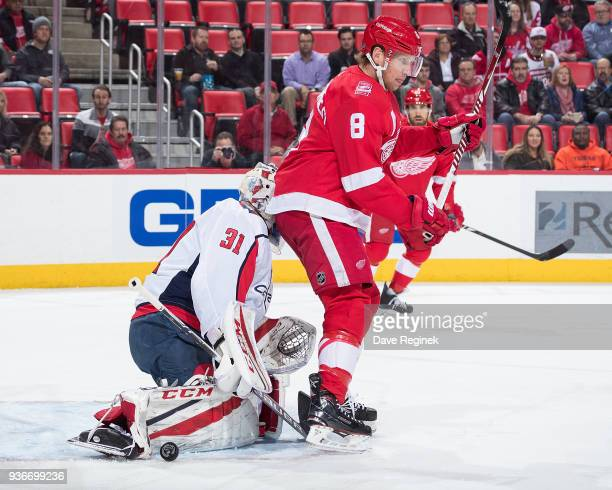 Goaltender Philipp Grubauer of the Washington Capitals makes a save as he is screened by Justin Abdelkader of the Detroit Red Wings during an NHL...