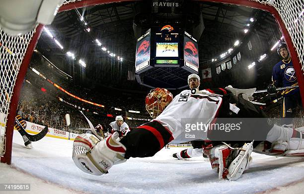 Goaltender Ray Emery of the Ottawa Senators reaches but fails to stop the puck after it was tipped in by Maxim Afinogenov of the Buffalo Sabres to...