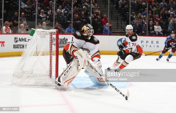 Goaltender Reto Berra of the Anaheim Ducks clears the puck against the Colorado Avalanche at the Pepsi Center on October 13 2017 in Denver Colorado...