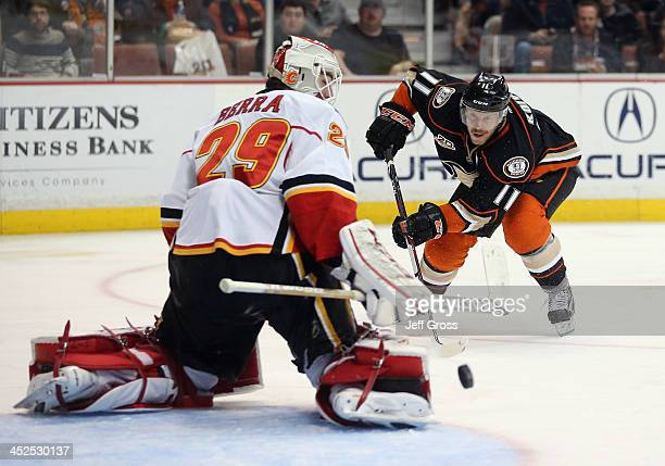 Goaltender Reto Berra of the Calgary Flames makes a save on a shot by Saku Koivu of the Anaheim Ducks in the third period at Honda Center on November...