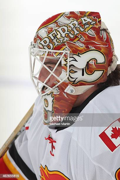 Goaltender Reto Berra of the Calgary Flames stretches prior to the game against the Colorado Avalanche at the Pepsi Center on January 06 2014 in...