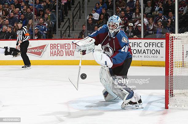 Goaltender Reto Berra of the Colorado Avalanche clears the puck against the Los Angeles Kings at the Pepsi Center on March 10 2015 in Denver Colorado...