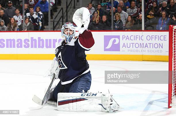 Goaltender Reto Berra of the Colorado Avalanche makes a glove save against the New York Rangers at the Pepsi Center on November 6 2015 in Denver...