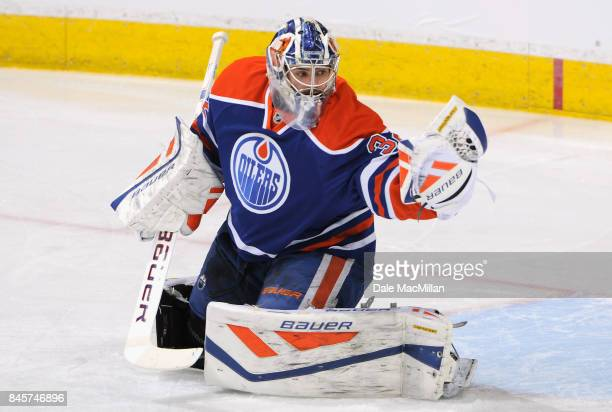 Goaltender Richard Bachman of the Edmonton Oilers warms up before the game against the Philadelphia Flyers at Rexall Place on March 21 2015 in...