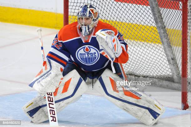 Goaltender Richard Bachman of the Edmonton Oilers warms up before the game against the Dallas Stars at Rexall Place on March 27 2015 in Edmonton...
