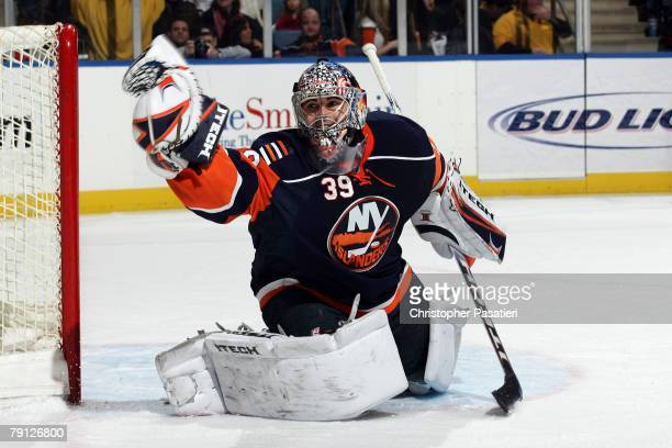 Goaltender Rick DiPietro of the New York Islanders makes a glove save against the Philadelphia Flyers during the second period on January 19 2008 at...