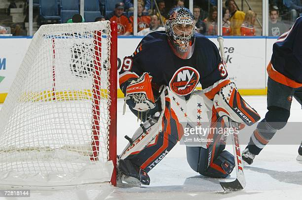 Goaltender Rick DiPietro of the New York Islanders watches play as he gets set for a shot during their NHL game against the Montreal Canadiens on...